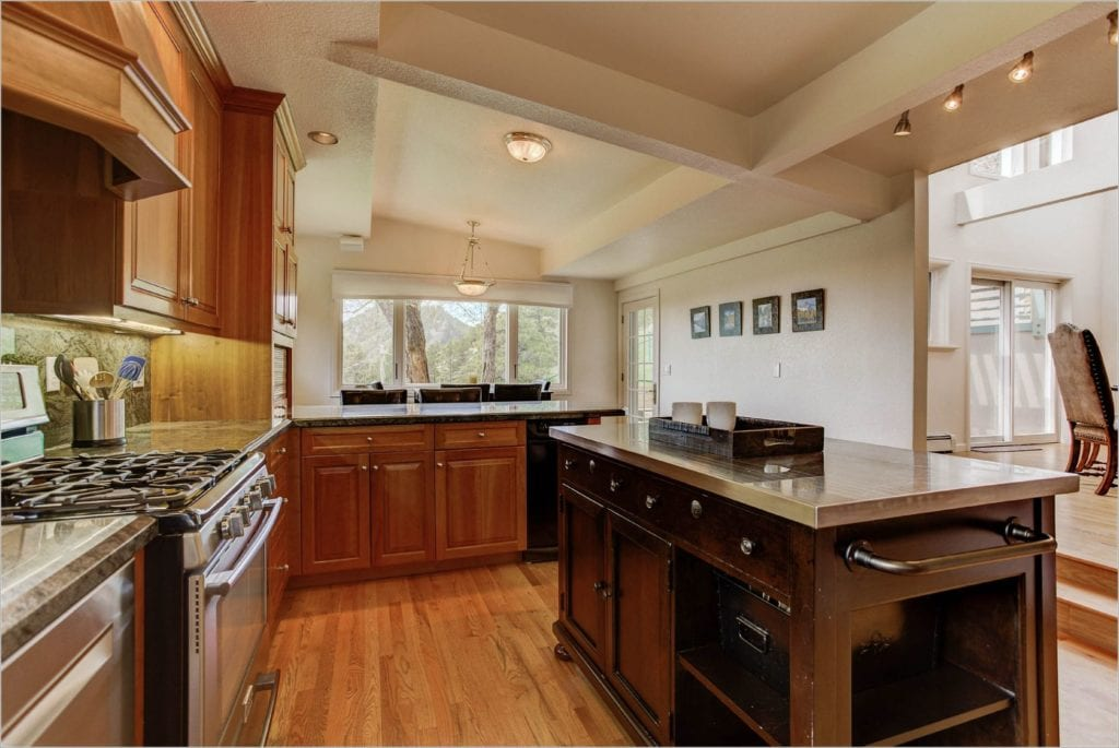 The kitchen has access a dine-in nook and access to the dining room.